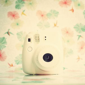 Vintage white instant camera