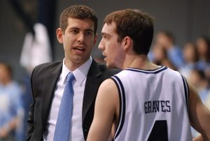 Coach Brad Stevens talking to AJ Graves at Butler University game.