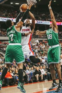 Jared Sullinger (left) blocking the Piston's Greg Monroe.