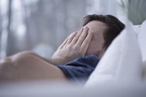 Man having some sleeping disorders like insomnia
