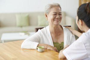 Elderly woman talking to nurse in hospital